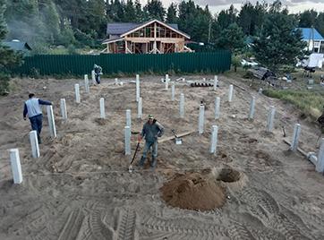 Установка фундамента на железобетонных сваях под дом в поселке Рощинский хутор